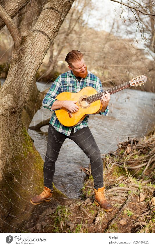 Red haired man Leisure and hobbies Playing Entertainment Music Human being Man Adults Musician Guitar Nature River Red-haired Moustache Cool (slang)