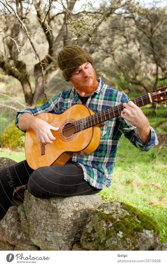 Hipster man with red beard Leisure and hobbies Playing Entertainment Music Human being Man Adults Musician Guitar Nature Red-haired Moustache Cool (slang)