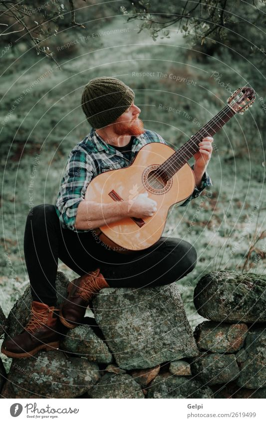 Hipster man with red beard Leisure and hobbies Playing Entertainment Music Human being Man Adults Musician Guitar Nature Hat Red-haired Moustache Cool (slang)