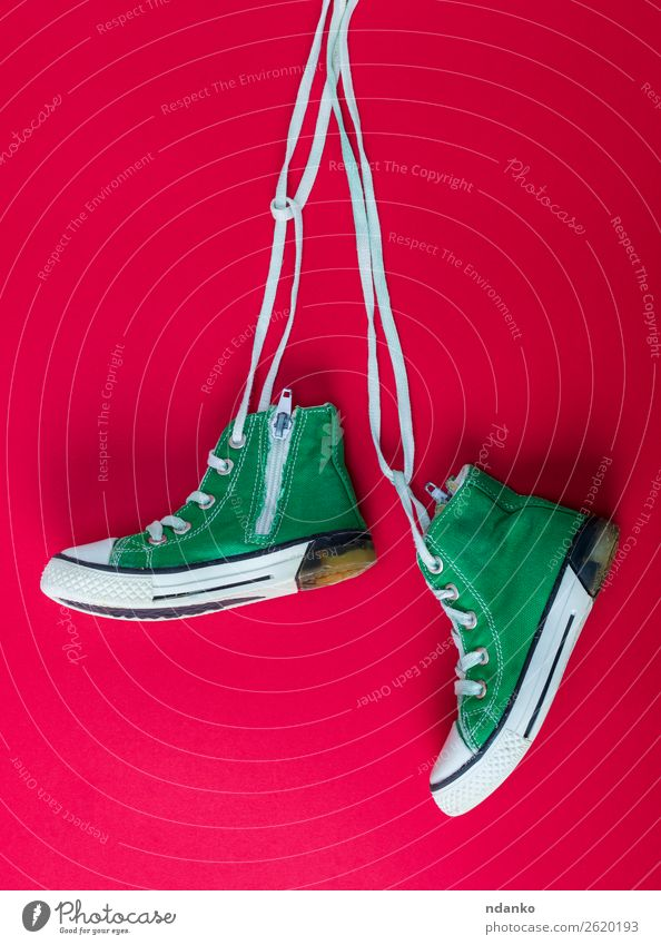 pair of worn textile sneakers with white laces Green White Red Lifestyle Sports Style Fashion Retro Modern Footwear Fitness Clothing Rope Hip & trendy Hang Lace