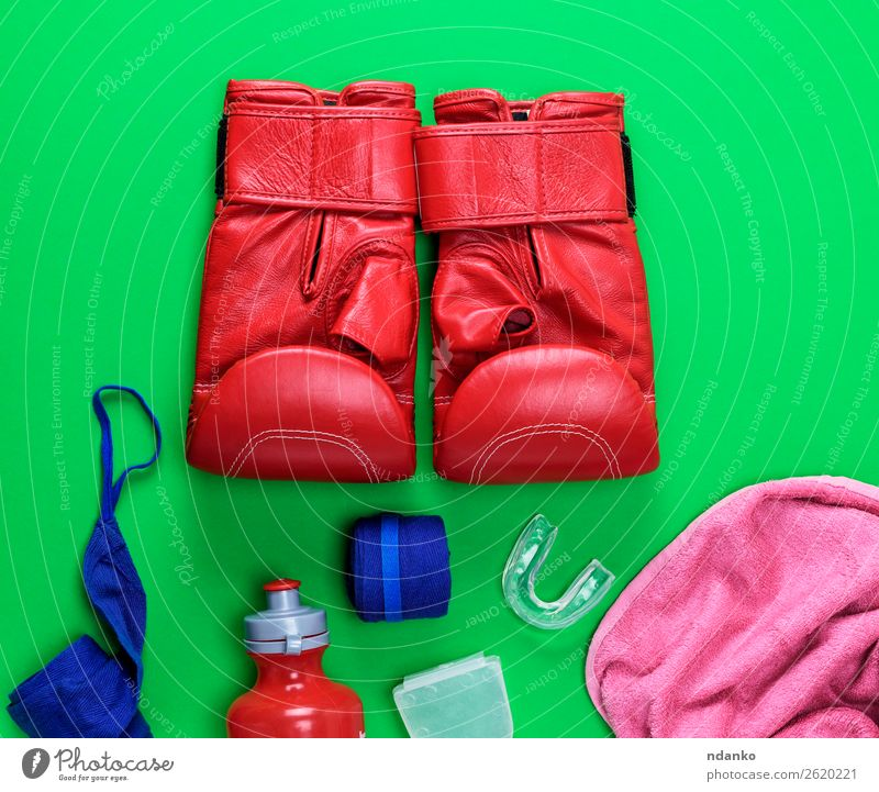 red leather boxing gloves, a plastic water bottle Bottle Fitness Sports Success Leather Gloves Above Blue Green Pink Red Might Protection Idea Competition