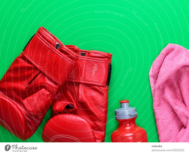 red leather boxing gloves, a plastic water bottle Bottle Sports Leather Gloves Fitness Above Green Pink Red Protection Competition Creativity Boxing pair