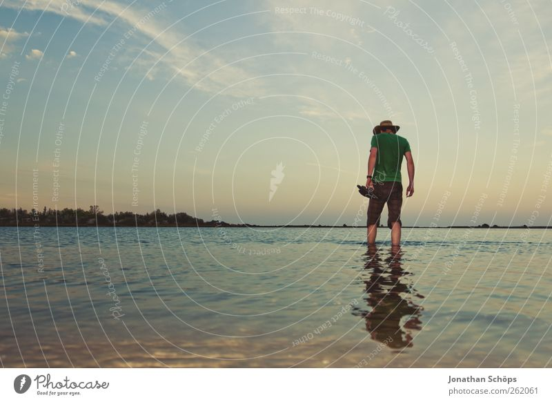 Man with hat stands in shallow water on the beach Vacation & Travel Trip Adventure Far-off places Freedom Summer Summer vacation Beach Ocean Human being