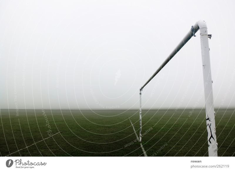 gate Sports Ball sports Goalkeeper Soccer Sporting Complex Football pitch Bad weather Storm Fog Meadow Dirty Dark Sharp-edged Cold Wet Gloomy Empty Loneliness