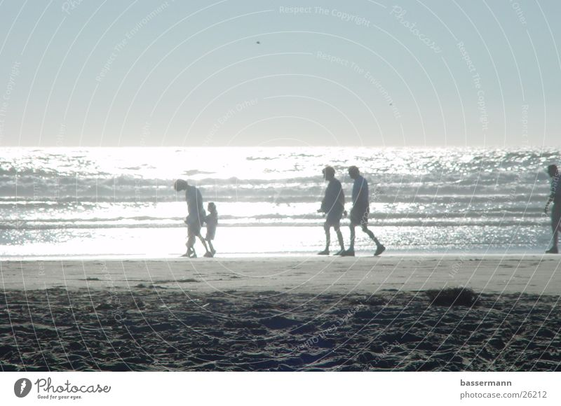A Walk at the Beach Ocean Pacific Ocean Cannon Beach Oregon Back-light Human being To go for a walk Sandy beach Horizon Walk on the beach Pedestrian Tourism