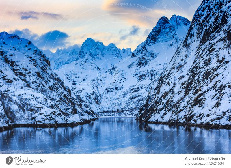View of trollfjord with snow capped mountains on lofoten islands Sky Vacation & Travel Nature Blue Landscape Ocean Winter Mountain Snow Coast Rock Hiking Europe