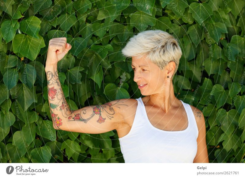 Blonde woman Lifestyle Style Happy Beautiful Body Summer Woman Adults Arm Nature Plant Flower Park Fashion Tattoo Fitness Smiling Cool (slang) Strong Blue Red