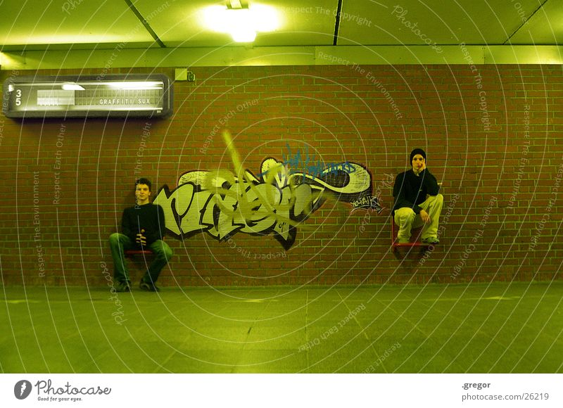 graffiti sux full Green Painting and drawing (object) Human being Graffiti Train station Sit Seating