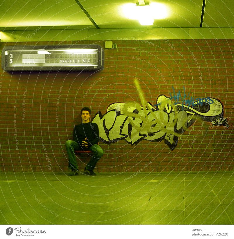 Human being Green Graffiti Sit Painting and drawing (object) Train station Seating Display