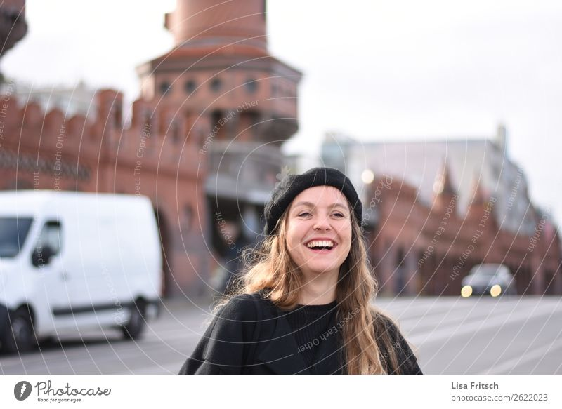 Woman, cap, laugh, Berlin Vacation & Travel Sightseeing City trip Adults 1 Human being 18 - 30 years Youth (Young adults) Wall (barrier) Wall (building)