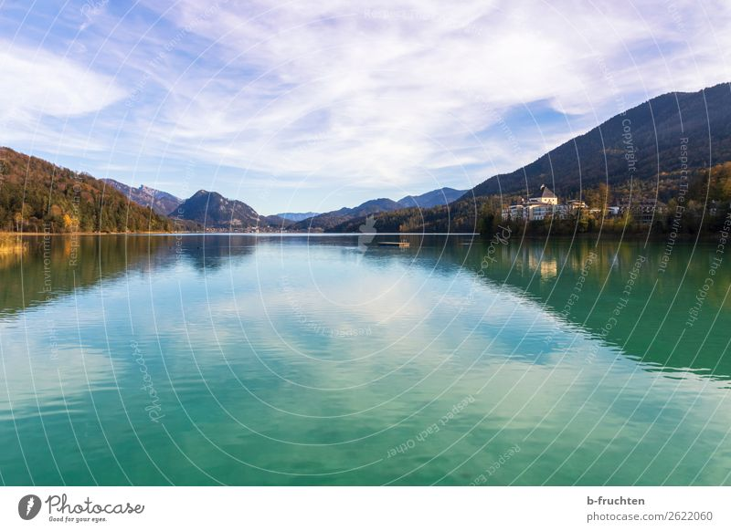 Lake with castle and mountains in the background Leisure and hobbies Vacation & Travel Mountain Nature Landscape Sky Clouds Autumn Beautiful weather Forest Alps
