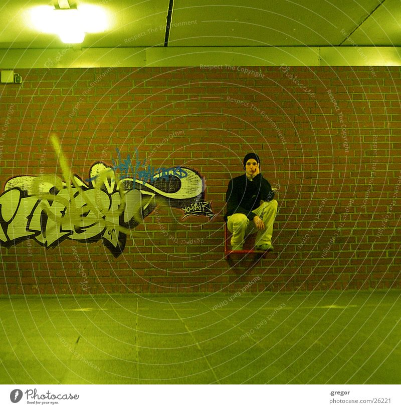 Human being Green Graffiti Sit Painting and drawing (object) Train station Seating