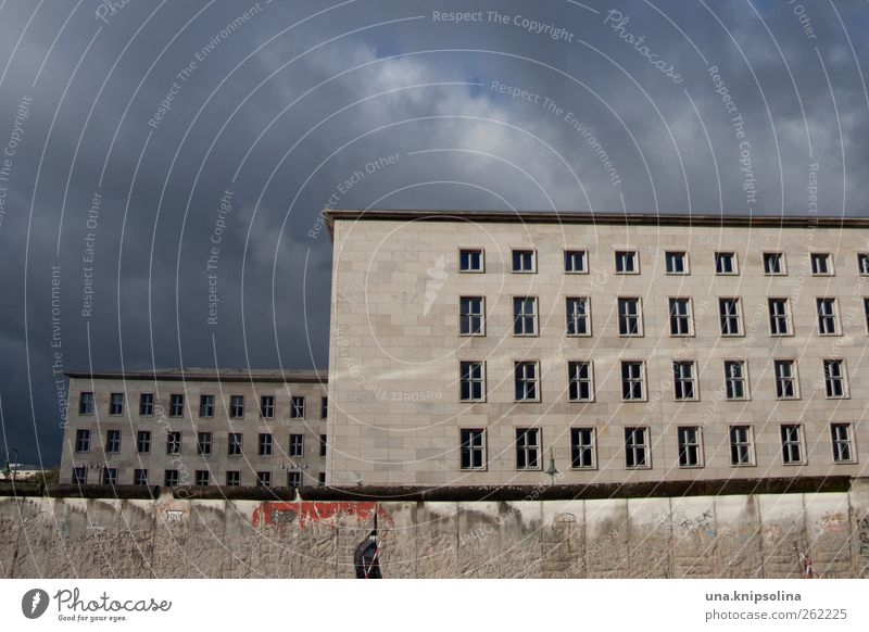 City Clouds Wall (building) Berlin Architecture Wall (barrier) Building Concrete Threat Beautiful weather Downtown Capital city Tourist Attraction Sharp-edged