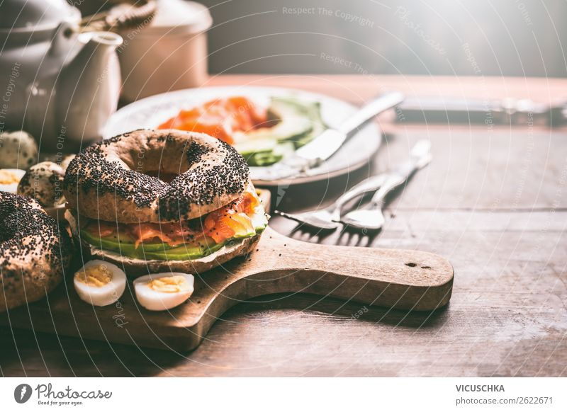 Bagel sandwich with salmon and quail eggs Food Roll Nutrition Breakfast Hot drink Crockery Style Design Living or residing Eating Sandwich Background picture