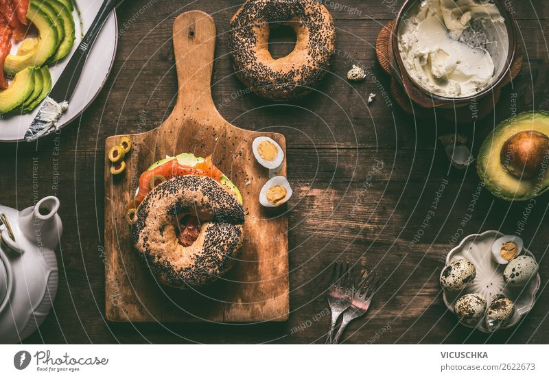 Breakfast with bagel bread roll Food Roll Nutrition Style Design Living or residing Bagel Background picture Sandwich Snack Salmon Avocado Quail's egg