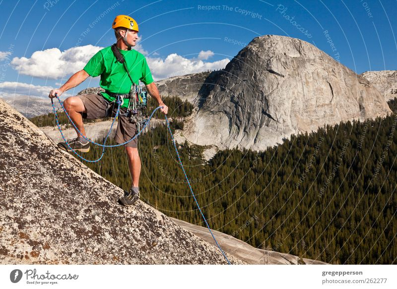 Climber conquering the summit. Human being Man Nature Adults Life Contentment Rock Hiking Adventure Rope Success Authentic Uniqueness Climbing Trust Peak