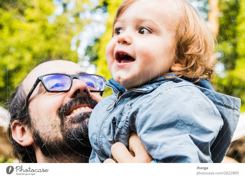 A father with his baby in his arms Child Human being Vacation & Travel Nature Man Summer Green Landscape White Forest Mountain Lifestyle Adults Sports