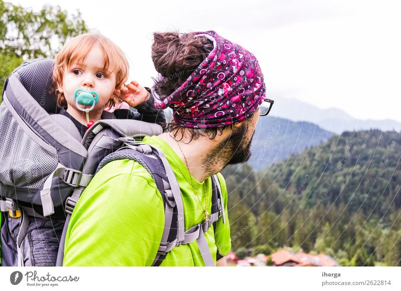 A father with his baby in the mountain Child Human being Vacation & Travel Nature Man Summer Green Landscape White Forest Mountain Lifestyle Adults Sports
