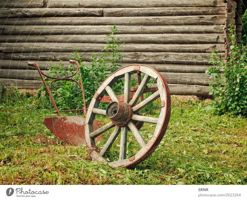 wheel and plough Grass Village Wood Rust Old Historic Retro Nostalgia agricultural Ancient Antique Cartwheel country Grunge Object photography Old fashioned