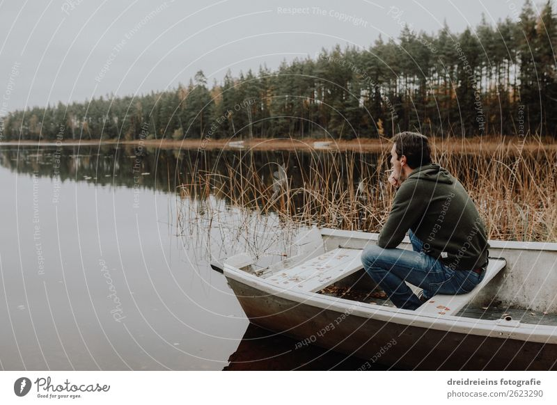 Man sits in boat by the lake Vacation & Travel Adventure Human being Adults Nature Autumn Lake River Relaxation Smoking Sit Dream Wait Authentic Natural Happy
