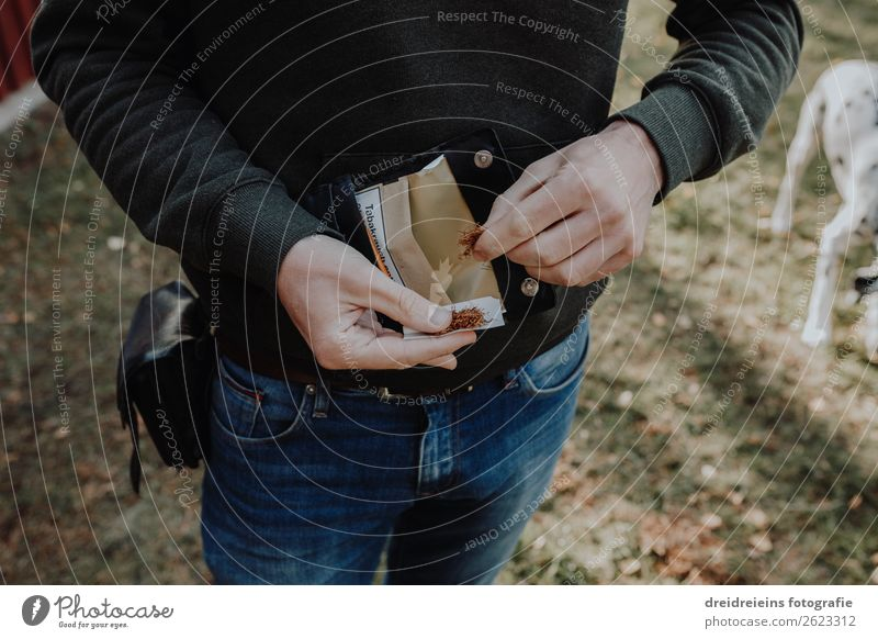 Man roll cigarette with tobacco Tobacco Cigarette Rotate hands Manly Tobacco pouch To enjoy Smoking Healthy