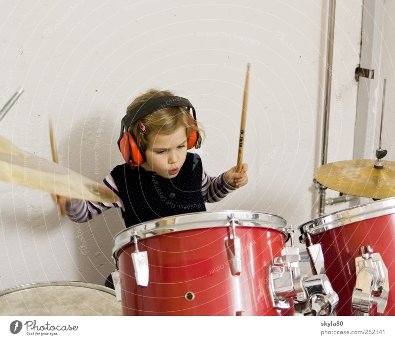 rock concert girl Child Toddler Infancy Playing Joy Drum set Music Musical instrument headphones Ear protectors Leisure and hobbies Make music play music Sound