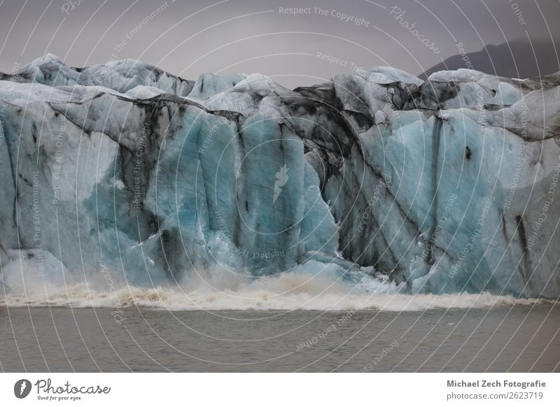 glacier crashes into water on lagoon fjallsarlon in iceland Vacation & Travel Tourism Trip Summer Island Snow Mountain Hiking Nature Landscape Sky Clouds