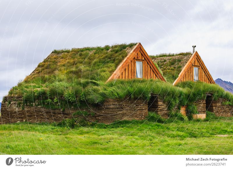 two green houses with gras roof in iceland in summer House (Residential Structure) Grass Meadow Rock Hut Building Architecture Roof Wood Green agriculture