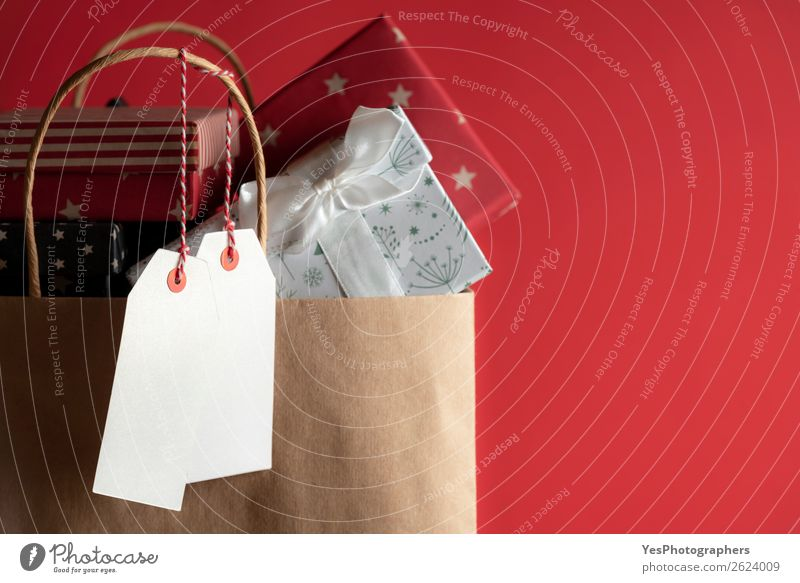 two blank tags and a bag full of gifts a royalty free stock photo from photocase