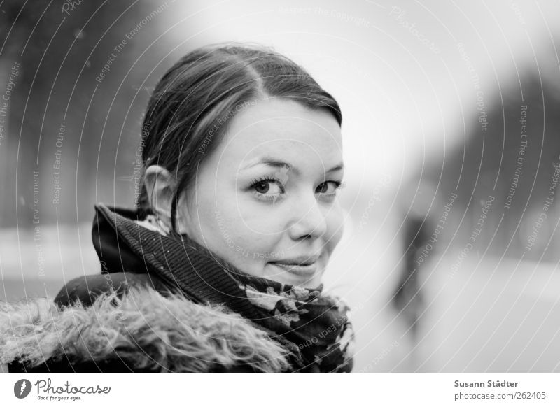 tart Feminine Head Hair and hairstyles Face Clothing Jacket Brunette Observe Rotate Impish Smiling Snowfall Winter Blur Black & white photo Copy Space right