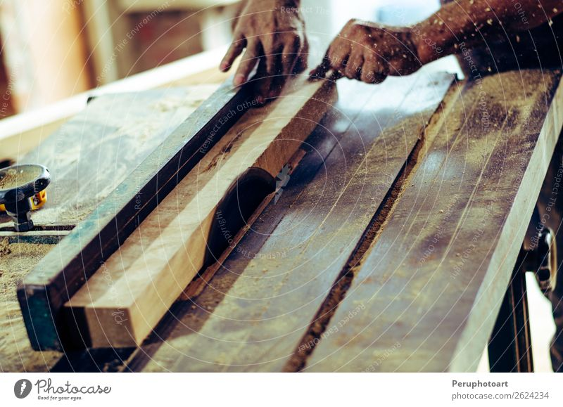 Carpenter tools on wooden table with sawdust. Circular Saw. Human being Man Hand Adults Wood Work and employment Metal Table Industry Safety Teeth Home Steel