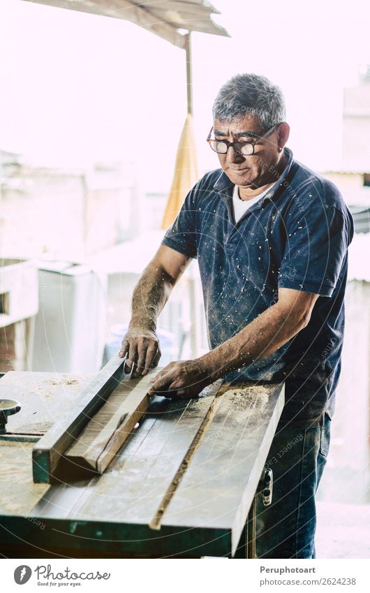 Carpenter cutting wooden board Desk Work and employment Industry Craft (trade) Business Tool Saw Human being Man Adults Hand Building Wood Metal Safety