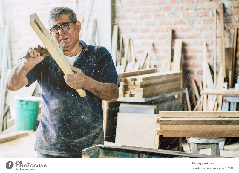 Senior carpenter checking wooden plank. Furniture Work and employment Craftsperson Industry Business Man Adults Grandfather Beard Old Make Authentic