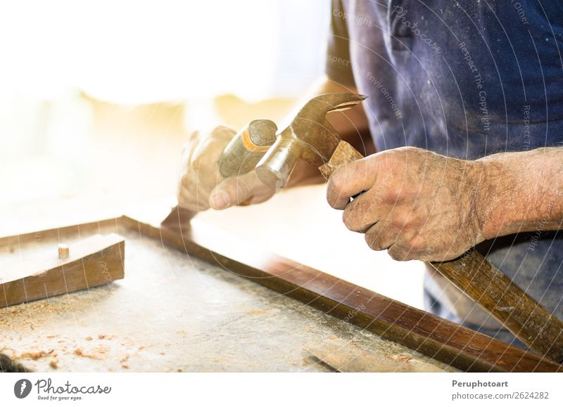 Carpenter works with a chisel and a hammer. Man Old Hand Adults Wood Building Work and employment Leisure and hobbies Action Industry Tradition Furniture