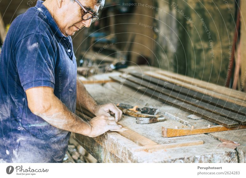 Professional carpenter sanding and refinishing wood surface. Human being Man Old Hand Adults Wood Art Sand Work and employment Leisure and hobbies Table Paper