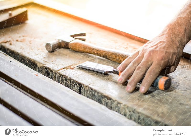 Carpenter working with a chisel and a hammer. Man Old Hand Adults Wood Building Work and employment Leisure and hobbies Action Industry Tradition Furniture