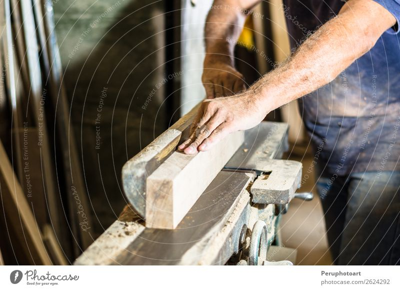 Carpenter with circular saw cutting a wooden. Human being Man Hand Adults Wood Work and employment Metal Table Industry Safety Teeth Home Steel Craft (trade)