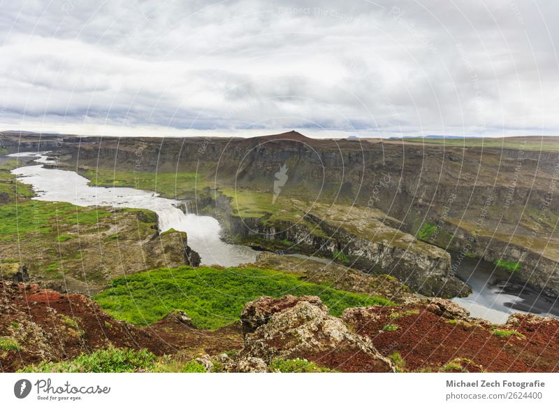 Landscape panorama of hafragilsfoss waterfall in iceland Beautiful Vacation & Travel Tourism Sightseeing Summer Mountain Nature Clouds Grass Park Hill Rock