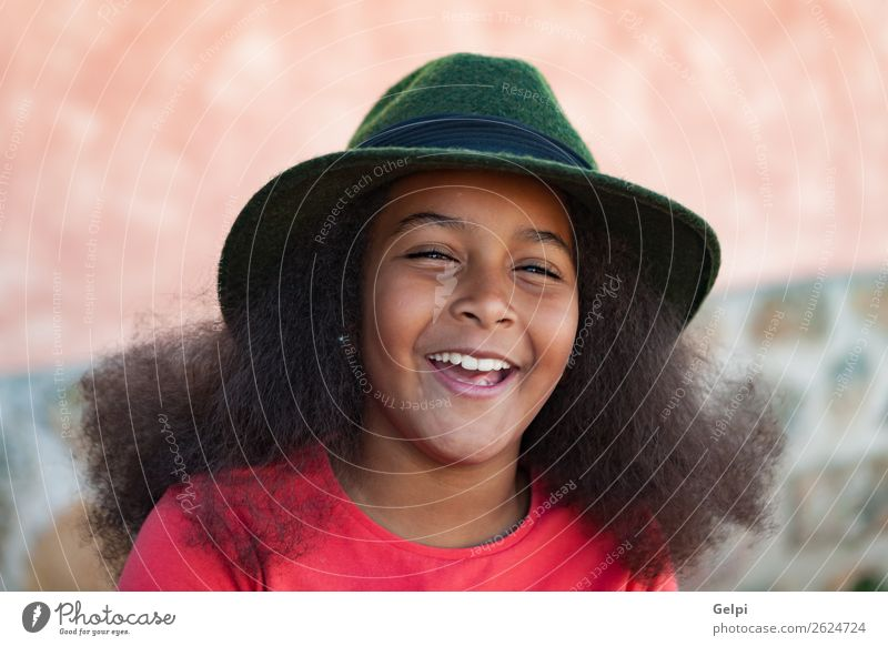 Pretty girl with long afro hair Elegant Happy Beautiful Face Winter Garden Child Human being Woman Adults Infancy Park Fashion Hat Brunette Afro Smiling