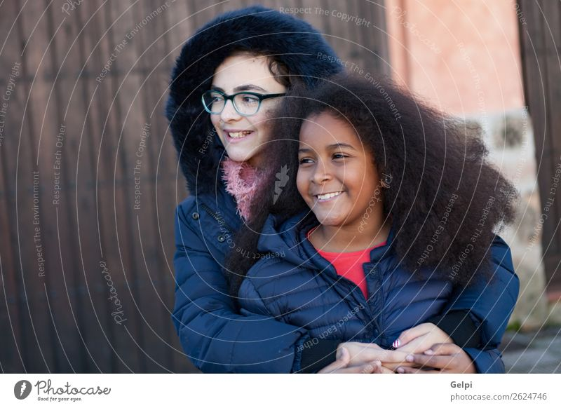 Two happy girls friends Joy Happy Beautiful Face Child Human being Family & Relations Friendship Infancy Street Afro Smiling Embrace Happiness Together Small