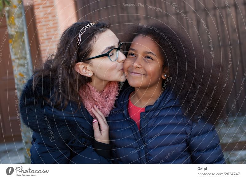 Two happy girls friends Joy Happy Beautiful Face Child Human being Family & Relations Friendship Infancy Street Afro Kissing Smiling Happiness Together Small
