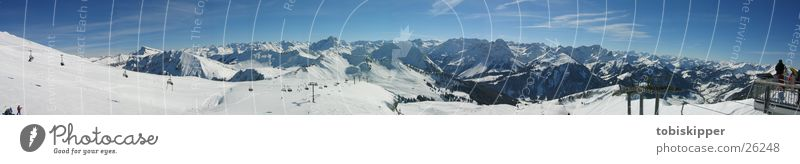 Alpine panorama while skiing Leisure and hobbies Trip Far-off places Winter Snow Mountain Sports Winter sports Skiing Alps Peak Cable car Large Top terminal