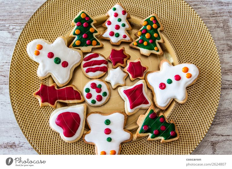 Christmas cookies on a dish with a wooden table background Nature Man Christmas & Advent Beautiful Green White Red Tree Winter Food Eating Adults Wood Snow