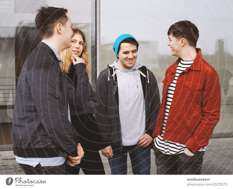 Group of teenage friends talking and laughing together Lifestyle Joy Leisure and hobbies Human being Masculine Feminine Young woman Youth (Young adults)
