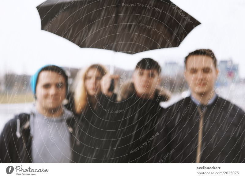 Friends in the rain - defocused Lifestyle Human being Young woman Youth (Young adults) Young man Woman Adults Man 4 Group 13 - 18 years 18 - 30 years Weather