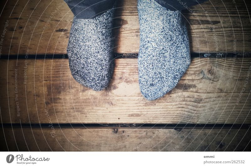 white noise Feet 1 Human being Stockings Wood Sit Old Authentic Simple Gloomy Brown Gray Black White Calm Stagnating Wooden floor Vignetting Colour photo