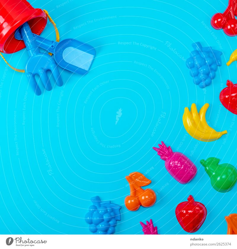 Blue background with childrens colorful toys Child Colour Green Red Joy Yellow Playing Fruit Pink Above Design Bright Decoration Infancy Creativity