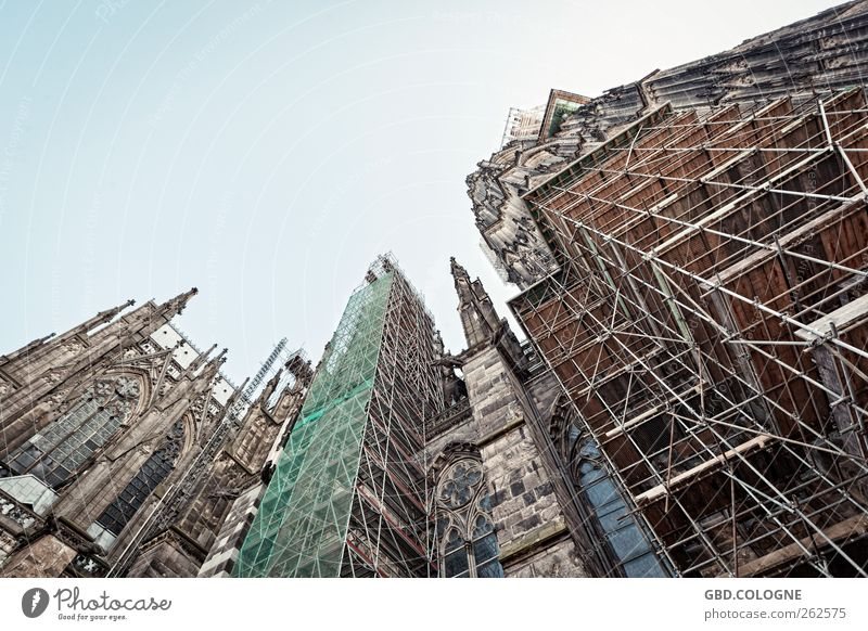 Rescue from eternal decay | Cologne Cathedral Cloudless sky Beautiful weather Germany Town Downtown Dome Tourist Attraction Landmark Stone Concrete Steel Old