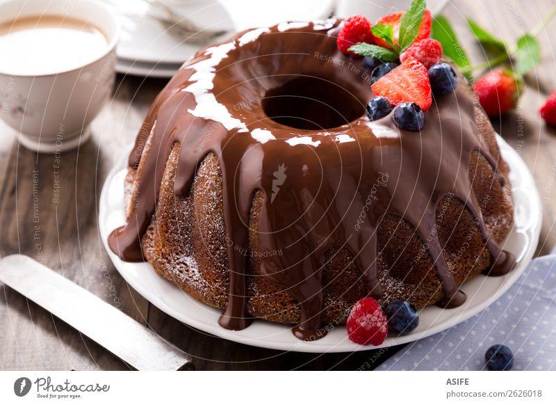 Chocolate bundt cake with berries Fruit Dessert Breakfast Hot Chocolate Coffee Tea Birthday Leaf Wood Fresh Brown chocolate glaze Berries Strawberry Blackberry