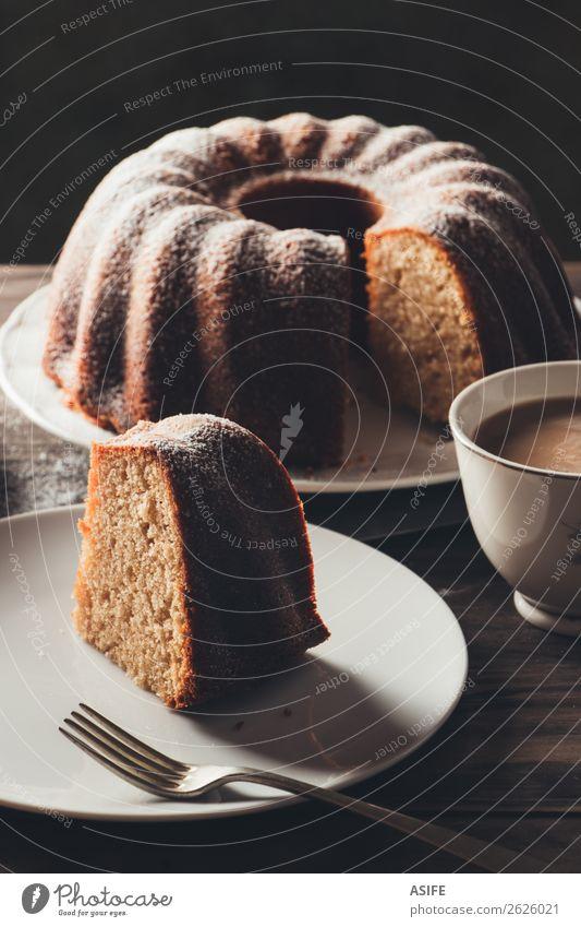 Piece of bundt cake with coffee Yoghurt Dessert Breakfast Coffee Tea Plate Fork Table Wood Dark Fresh Juicy Brown Tradition Baking food Home-made sweet Bakery